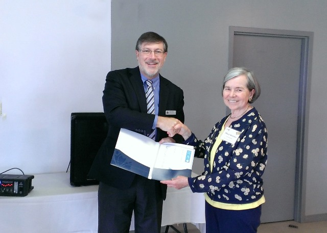 Simon Coakley, CEO National Association of Federal Retirees (NAFR) Presenting volunteer award to Mary Stevens.
