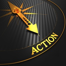 A compass needle pointing at the word action.