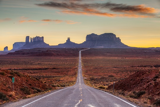 A road leading to Monument Valley at sunset.